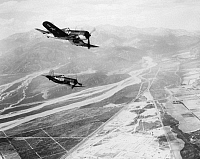 0102485 © Granger - Historical Picture ArchiveKOREAN WAR: AIRPLANES.   Carrier planes (possibly Chance Vought F4U Corsairs) of the U.S. Marine Corps flying over North Korea, c1950.