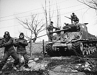 0102518 © Granger - Historical Picture ArchiveKOREAN WAR: TANK, 1951.   The crew of an Allied tank uses a lull in fighting near the Korean central front north of Wonju, to clean weapons, 15 February 1951.
