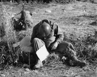 0102543 © Granger - Historical Picture ArchiveKOREAN WAR: WRITING HOME.   While waiting for transportation after fighting on Triangle Hill, a GI wanted to write home, but exhaustion got the better of him. Photograph, November 1952.