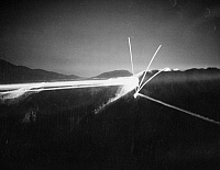 0102613 © Granger - Historical Picture ArchiveKOREAN WAR: SEARCHLIGHTS.   U.S. 8th Army searchlights and infantry machine gun fire light up enemy positions during fighting on the Korean front, October 1952.