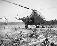 0102645 © Granger - Historical Picture ArchiveKOREAN WAR: TRAINING, 1952.   Paratrooper assault troops jump from a H-19 helicopter during a maneuver at Fort Bragg, North Carolina, September 1952.