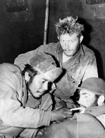 0621684 © Granger - Historical Picture ArchiveKOREAN WAR: SOLDIERS, 1951.   Three American soldiers, recently freed by Chinese captors, recover in a medical clearing station in Korea. From left to right: Joe Wright, Paul Cramer, and Robert Nash. Photograph, 1951.
