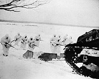 0000312 © Granger - Historical Picture ArchiveRUSSO-FINNISH WAR, 1939-40.   Soviet snow fighters advance behind a tank which tows an armored sled into which they can duck when caught in fire from the Finnish line, 1939-40.
