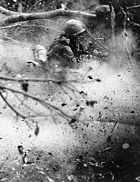 0048905 © Granger - Historical Picture ArchiveVIETNAM WAR: 1st INFANTRY.   A soldier in the First Infantry Division ducks from the back blast of a 106mm recoilless rifle during Operation Paul Revere IV, December 1966.