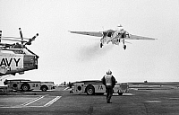 0078401 © Granger - Historical Picture ArchiveVIETNAM WAR: F-14A TOMCAT.   A F-14A Tomcat fighter passes over aircraft carrier U.S.S. Forrestal, December 1973.