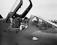 0078403 © Granger - Historical Picture ArchiveVIETNAM WAR: U.S. AVIATOR.   At an air base in South Vietnam a pilot of the U.S. Air Force's 354th Tactical Fighter Squadron checks the controls of his F-105 Thunderchief aircraft, July 1966.