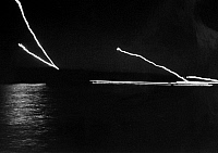 0102184 © Granger - Historical Picture ArchiveVIETNAM WAR: MEKONG DELTA.   Flares and gun fire light the night sky as a South Vietnamese gunboat exchanges fire with Viet Cong on the shore, March 1965.