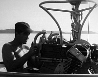 0102265 © Granger - Historical Picture ArchiveVIETNAM WAR: SWIFT BOAT.   A U.S. Navy petty officer cleans the 50 caliber machine gun on a Swift boat off the coast of South Vietnam, February 1966.