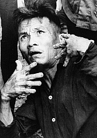 0102356 © Granger - Historical Picture ArchiveVIETNAM WAR: VICTIM, 1969.   Do Chuc shows his gnarled hands while describing the massacre performed by American soldiers in his village, Truong Khan (or An), in April 1969. Photograph, November 1969.