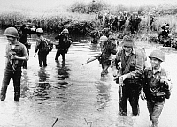 0102357 © Granger - Historical Picture ArchiveVIETNAM WAR: VIETNAMIZATION.  Australian troops cross a stream during a sweep near Saigon alongside members of the South Vietnamese 18th Division, October 1969.