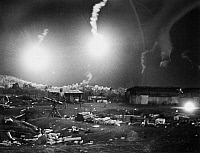 0102366 © Granger - Historical Picture ArchiveVIETNAM WAR: FLARES, 1966.   Flares from an U.S. Air Force plane drop at night over a U.S. Special Forces outpost under attack, February 1966.