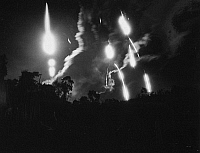 0102380 © Granger - Historical Picture ArchiveVIETNAM WAR: FLARES, 1966.   Flares from an American aircraft and from ground artillery help a U.S. Marine company under attack in South Vietnam near the Demilitarized Zone, September 1966.