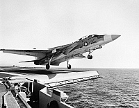 0102414 © Granger - Historical Picture ArchiveAIRCRAFT CARRIER AND JET.   An F-14A Tomcat fighter aircraft is launched from the attack aircraft carrier USS Forrestal in the Atlantic Ocean, December 1973.