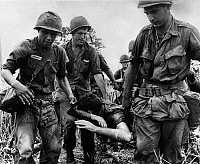 0132567 © Granger - Historical Picture ArchiveVIETNAM WAR, 1966.   Soldiers of the US 16th Infantry carrying a wounded comrade to safety in a poncho, 1966.