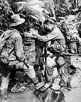 0176785 © Granger - Historical Picture ArchiveVIETNAM WAR: PATROL, 1964.   U.S. Army Major David R. Pinney attempting to explain something to the head of a group of Nung merecenaries while leading a patrol on the Ho Chi Minh Trail during the Vietnam War, December 1964.
