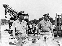 0176788 © Granger - Historical Picture ArchiveVIETNAM WAR: NAVAL SUPPORT.   Rear Admirals Edwin B. Hooper (left) and Thomas R. Weschler of the U.S. Navy overseeing the Naval Support Activity at Da Nang, South Vietnam, by which ground forces fighting in the country's northernmost provinces were kept supplied, 5 February 1966. In the background is Commander A.E. Boule, Weschler's Deputy Chief of Staff.