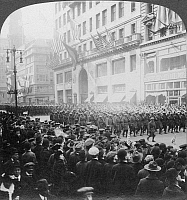 0006225 © Granger - Historical Picture ArchiveWORLD WAR I: BLACK TROOPS.   Black veterans of the 15th Regiment, 369th Infantry, marching up Fifth Avenue, New York, 17 February 1919. From a stereograph view.