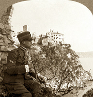 0053950 © Granger - Historical Picture ArchiveWORLD WAR I: DUINO CASTLE.   An Italian soldier poses at the Castle of Duino on the Gulf of Trieste. Stereograph, late 1918.