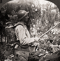 0079649 © Granger - Historical Picture ArchiveWORLD WAR I: FLAMETHROWER.   Stereograph view of a soldier with a flamethrower taken from Austrian forces in Capitello, Italy, 1914-1918.