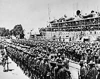 0132575 © Granger - Historical Picture ArchiveWORLD WAR I: TROOPS.   Soldiers in the first transport of American troops to France lining up on a quai at St. Nazaire, 26 June 1917.