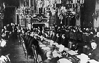 0166566 © Granger - Historical Picture ArchiveWWI: TREATY NEGOTIATIONS.   Meeting at the French Ministry of Foreign Affairs at Quai D'Orsay, Paris. Under clock are American and French presidents Woodrow Wilson and Raymond Poincaré. Next to Wilson is Robert Lansing. Also seated: Edward House, David Lloyd George, Arthur Balfour, Andrew Bonar Law. At left: Georges Clemenceau, Stépen Pichon, Ferdinand Foch.
