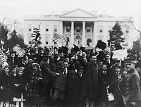 0166567 © Granger - Historical Picture ArchiveD.C.: ARMISTICE, 1918.   A crowd celebrating the victory and armistice at the end of World War I, outside the White House in Washington, D.C., 1918.