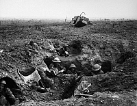 0167364 © Granger - Historical Picture ArchiveWORLD WAR I: YPRES, 1917.   British troops in a gun-pit trench with a destroyed Mark IV tank in the background. Photographed during the battle at Menin Road Ridge, part of the Battle of Ypres, 22 September 1917.
