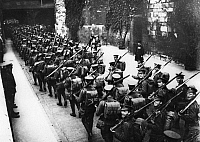 0183774 © Granger - Historical Picture ArchiveWORLD WAR I: SCOTTISH GUARD.   Scottish guardsmen marching out of the depot at the Tower of London, during World War I. Photograph, August 1914.