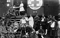 0216776 © Granger - Historical Picture ArchiveRED CROSS, c1918.   American Red Cross workers operating out of a railroad car in Poland during World War I. Photograph, c1918.