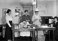 0322747 © Granger - Historical Picture ArchiveU.S. FOOD ADMINISTRATION.   Women at work in the United States Food Administration War Kitchen. The administration was responsible for the Allied Forces food reserves during World War I. Photograph, 1917.