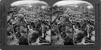 0325483 © Granger - Historical Picture ArchiveWORLD WAR I: RUINS, c1918.   Soldiers searching through the ruins of a town in France. Stereograph, c1918.