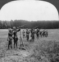 0325495 © Granger - Historical Picture ArchiveWORLD WAR I: MACHINE GUNS.   American troops guarding observation balloons with machine guns, in France, during World War I. Stereograph, c1917.