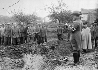 0353566 © Granger - Historical Picture ArchiveWWI: BURIAL, 1914.   A German field chaplain presiding over the burial of a French officer. Photograph, 1914.