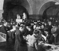 0370837 © Granger - Historical Picture ArchiveGERMAN WAR BONDS, 1915.   German civilians purchasing war bonds at the municipal savings bank in Charlottenburg, Germany. Photograph, 1915.