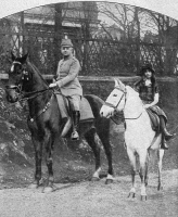 0370878 © Granger - Historical Picture ArchiveWORLD WAR I: OFFICER.   A young Prussian officer riding with the daughter of a farmer in Lille, France. Photograph, c1915.