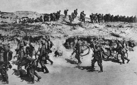 0407779 © Granger - Historical Picture ArchiveWORLD WAR I: GERMAN TROOPS.   German soldiers, some belonging to the bicycle corps, marching over sand dunes along the Belgian seacoast. Photograph, 1914-1918.