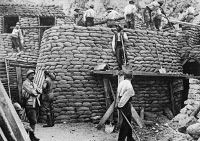 0407827 © Granger - Historical Picture ArchiveWORLD WAR I: FRENCH FORT.   French troops building a winter shelter out of sandbags in the Somme district of France during World War I. Photograph, 1914-1918.