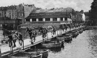 0407832 © Granger - Historical Picture ArchiveWORLD WAR I: PONTOON BRIDGE.   French cavalrymen leading their horses over a pontoon bridge in pursuit of the retreating German army after the First or Second Battle of the Marne, 1914 or 1918. Photograph.