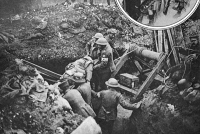 0407952 © Granger - Historical Picture ArchiveWORLD WAR I: CAMBRAI, 1917.   German prisoners of war operating a windlass to haul up British soldiers who were wounded and treated in an underground dressing station during the Battle of Cambrai, France, 1917.