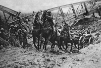 0407960 © Granger - Historical Picture ArchiveWORLD WAR I: ARTILLERY.   British field artillery crossing a dry canal bed because retreating Germans had blown up the bridge after a defeat during World War I. Photograph, c1917.