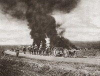 0408100 © Granger - Historical Picture ArchiveWORLD WAR I: BALKAN FRONT.   British artillery passing on a road and targeted by enemy air raid bombers, who instead struck houses in a nearby village, on the Balkan front during World War I. Photograph, c1916.
