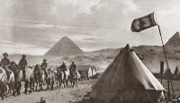 0408156 © Granger - Historical Picture ArchiveWORLD WAR I: EGYPT.   Two companies of colonial Scots with the Australian contingent of the British Army in Egypt. The Scottish flag is flying over their tents with the Great Pyramids in the background. Photograph, c1917.