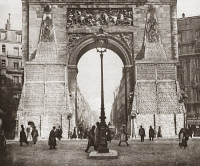 0408249 © Granger - Historical Picture ArchiveWORLD WAR I: ST. DENIS.   The base of the Porte Saint-Denis in Paris, France, being loaded with sandbags to protect it against bombardment from aerial raids and cannon fire during World War I. Photograph, c1916.