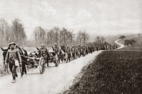 0408291 © Granger - Historical Picture ArchiveWWI: AMERICAN TROOPS.   An American machine-gun section marching along a road in Flanders during World War I. Photograph, c1917.