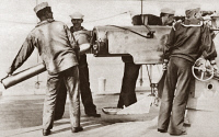 0408301 © Granger - Historical Picture ArchiveWORLD WAR I: U.S. NAVY.   Sailors loading a naval gun on board a merchant ship during World War I. Photograph, c1916.