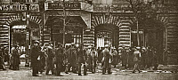 0409251 © Granger - Historical Picture ArchiveWORLD WAR I: REVOLUTION.   Crowd gathers outside of the Vorwaerts Newspaper plant, which was sacked by a mob and used as a fortress, Berlin, Germany. Photograph, c1919.