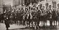 0409364 © Granger - Historical Picture ArchiveWORLD WAR I: BERLIN, C1918.   Squadron of Prussian Cavalry with decorated flagstaffs standing before a building decked in wreaths in Berlin, Germany. Photograph, c1918.