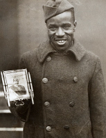 0528280 © Granger - Historical Picture ArchiveWWI: FRED McINTYRE, 1919.   Corporal Fred McIntyre of the 369th Infantry, with his lucky picture of the German Kaiser, returning home on board the 'SS Stockholm.' Photograph, 1919.