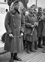 0528290 © Granger - Historical Picture ArchiveWWI: HOMECOMING, 1919.   Lieutenant James Reese Europe with the regimental band of the 369th Infantry Regiment returning home aboard the 'SS Stockholm.' Photograph, February 1919.