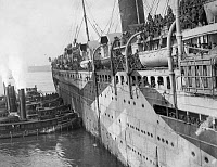 0528292 © Granger - Historical Picture ArchiveWWI: TROOPSHIP, 1919.   The troopship 'SS Stockholm' arriving in New York Harbor with one thousand members of the 369th Infantry Regiment. Photograph, February 1919.